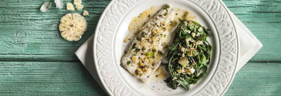 Sea bass with garlic and steamed greens